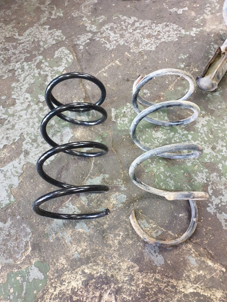 front coil spring replacement Mitsubishi Outlander